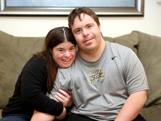 """Jillian Daugherty, 25, with her fiance, Ryan Mavriplis, 27, at their apartment in Symmes Township. """"He's ready for the wedding. He can't wait to get married to me,"""" Daugherty said. """"He loves me every day. He's an amazing guy. I'm glad I picked him. He puts a smile on my face."""""""