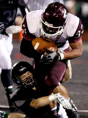 Franklin's Tun Way (33) is tackled at the ankles by