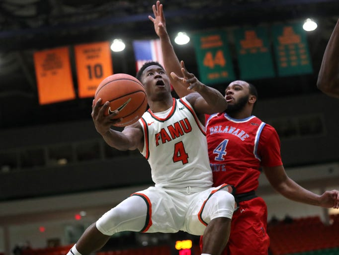 FAMU's Elijah Mayes lays the ball up past Delaware