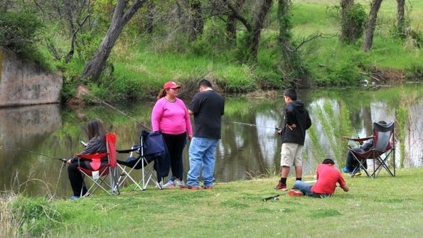 Nellie Doneva/Reporter-News People fish at Cal Young Park.