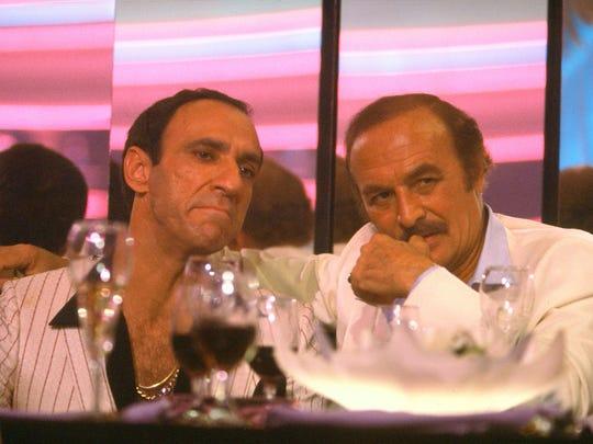 (L-R) F. Murray Abraham and Robert Loggia in a scene