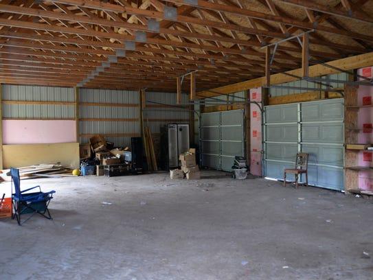 A three car garage at a home at 5306 Durfee Rd. in