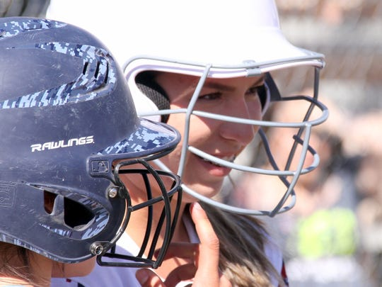 Lady Cat Brooke Huerta waits her turn at bat from the on-deck circle.