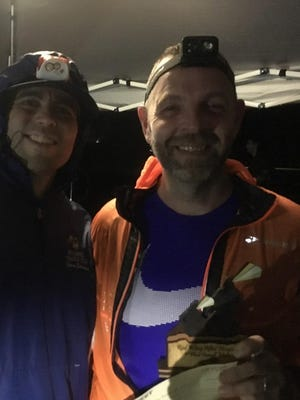 Ken Schneider, right, poses with race director Steven Estremera after Schneider won the Red Wing After Dark 8-kilometer trail race in LaGrangeville,