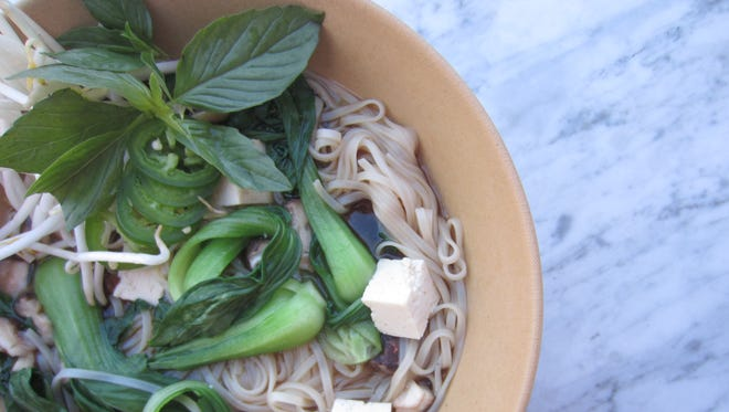 Faux pho is made with red miso shiitake broth, rice noodles, tofu, Thai basil, sprouts, chilies and lime.