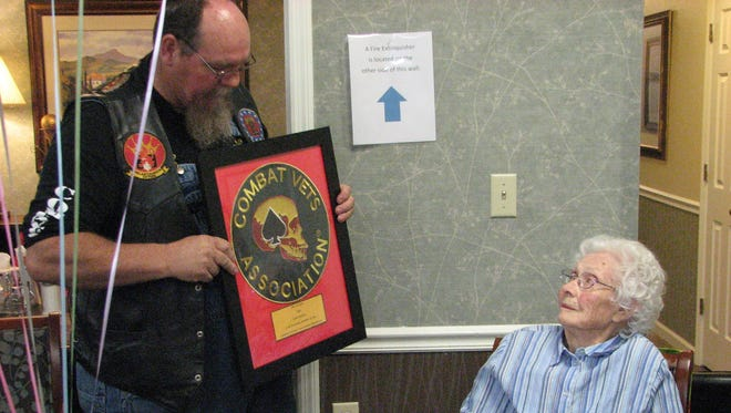 Michael Juris, commander of the Combat Veterans Association Chapter 4-9, surprised Gola Mealey during her 100th birthday party with the news that she had been made an honorary member of the chapter.