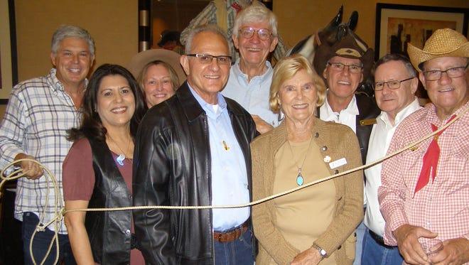 Board members and supporters were lassoed together in support of YMCA programs. (L-R) Gary Jeandron, Martha Jimenez, Michele DeMille, John Flavio, Jim Latting, Sally Simonds, Sabby Jonathon, Gary Galton, and Bill Powers