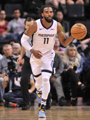 Memphis Grizzlies guard Mike Conley (11) brings the
