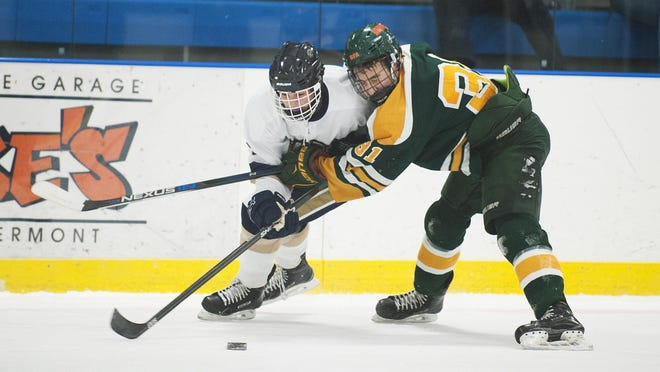BFA's Colby Brouillette (31) battles for the puck with Essex's Ryan Young (7) during the boys hockey game between the BFA St. Albans Bobwhites and the Essesx Hornets at the Essex Skating Facility on Wednesday night December 23, 2015 in Essex.