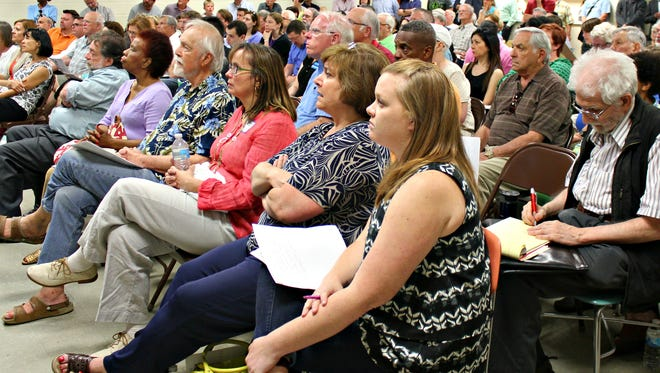 Concerned citizens from more than a dozen communities filled the Golf Manor meeting room at a Neighbors Opposing Pipeline Extension Town Hall meeting June 9.