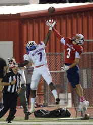 Woodlawn cornerback Corey Bell breaks up a pass to