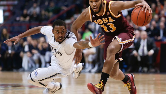 Monmouth guard Je'lon Hornbeak, left, defends against Iona guard Jahaad Proctor (13) during the first half of an NCAA men's college basketball game in the championship of the Metro Atlantic Athletic Conference tournament on Monday, March 7, 2016, in Albany, N.Y. (AP Photo/Mike Groll)