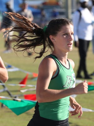 Fort Myers runner Krissy Gear won  the Girls 1,600 meters at LCAC. The meet was held at Island Coast High School. She works for her best times, but says she does it for her team. Gear congratulates each of the other runners after they finish.