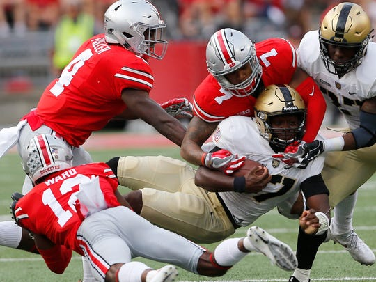 Army quarterback Ahmad Bradshaw is tackled by Ohio State safety Damon Webb.