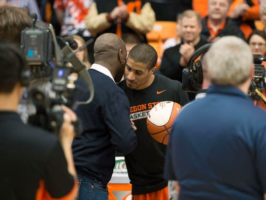 Feb 28, 2016; Corvallis, OR, USA; Oregon State guard Gary Payton II (right) is embraced by his father Gary Payton during a pregame ceremony honoring seniors before a game against Washington State at Gill Coliseum.