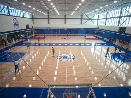 Sixers players and coaches work out on their brand new courts at their new training facility in Camden on Friday.