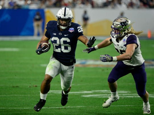 Dec 30, 2017; Glendale, AZ, USA; Penn State Nittany Lions running back Saquon Barkley (26) runs the ball as Washington Huskies linebacker Ben Burr-Kirven (25) defends during the second half during the 2017 Fiesta Bowl at University of Phoenix Stadium. Mandatory Credit: Matt Kartozian-USA TODAY Sports