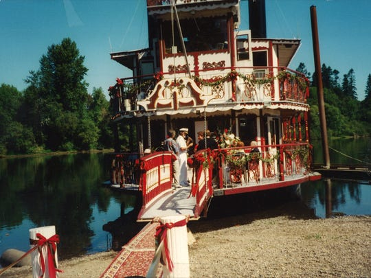 Richard and Barbara Chesbrough exchange wedding vows on the bow of the Willamette Queen on Aug. 30, 1998, at Monteith Riverpark in Albany.