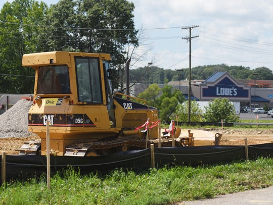 A bulldozer rests at the site of the iHOP being built
