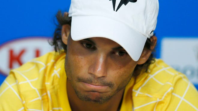 Rafael Nadal of Spain reacts during a press conference after losing his first round match against his compatriot Fernando Verdasco at the Australian Open  in Melbourne, Australia, Jan. 19, 2016.