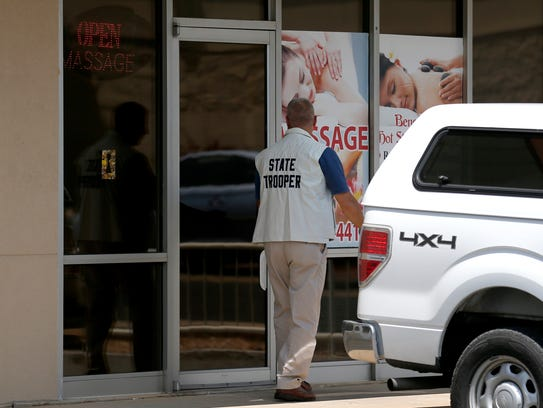 A Missouri State Highway Patrol investigator walking into Shui Massage and Spa at 520 W. University on Thursday, July 20, 2017.