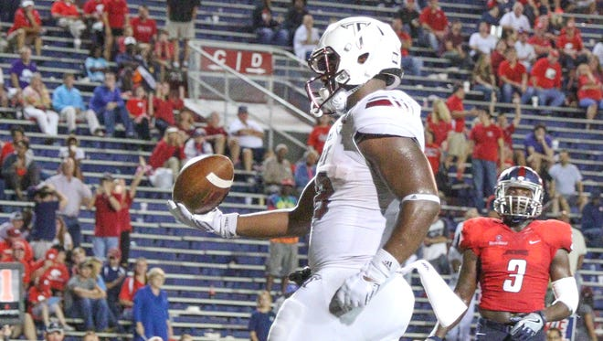 Troy running back Jordan Chunn (38) runs into the end zone for a touchdown during a game against South Alabama in Mobile, Ala. on Thursday, October 20, 2016.
