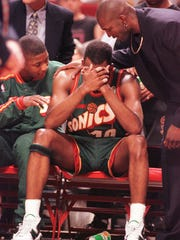 Seattle SuperSonics' Nate McMillan played injured in the 1996 NBA Finals against the Chicago Bulls. He was consoled in the fourth quarter of game six, in which the Bulls won the championship.