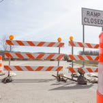 The eastbound entrance ramp to Interstate 96 from Spencer Road is closed as construction of the freeway resumes.