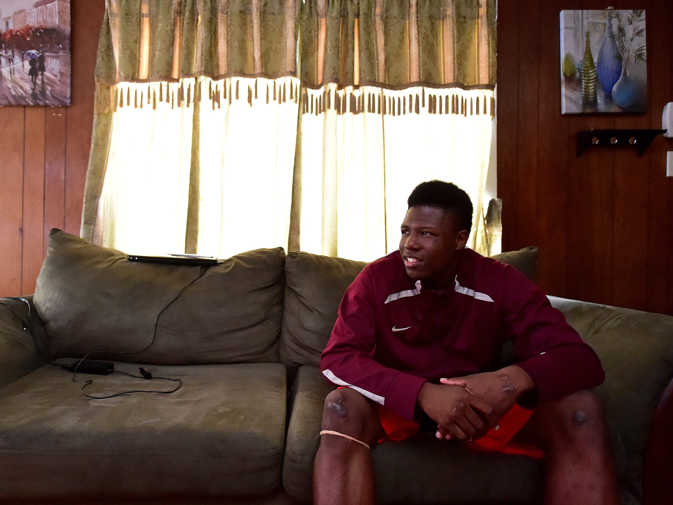Lanier athlete Jimmy Morton sits inside his home Thursday in Jackson. Morton has returned to school and athletics since a car wreck last summer.