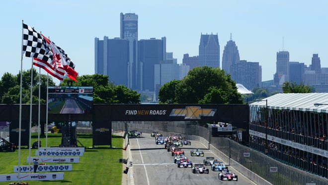 General Motors headquarters looms in the background over the Belle Isle track in Detroit.