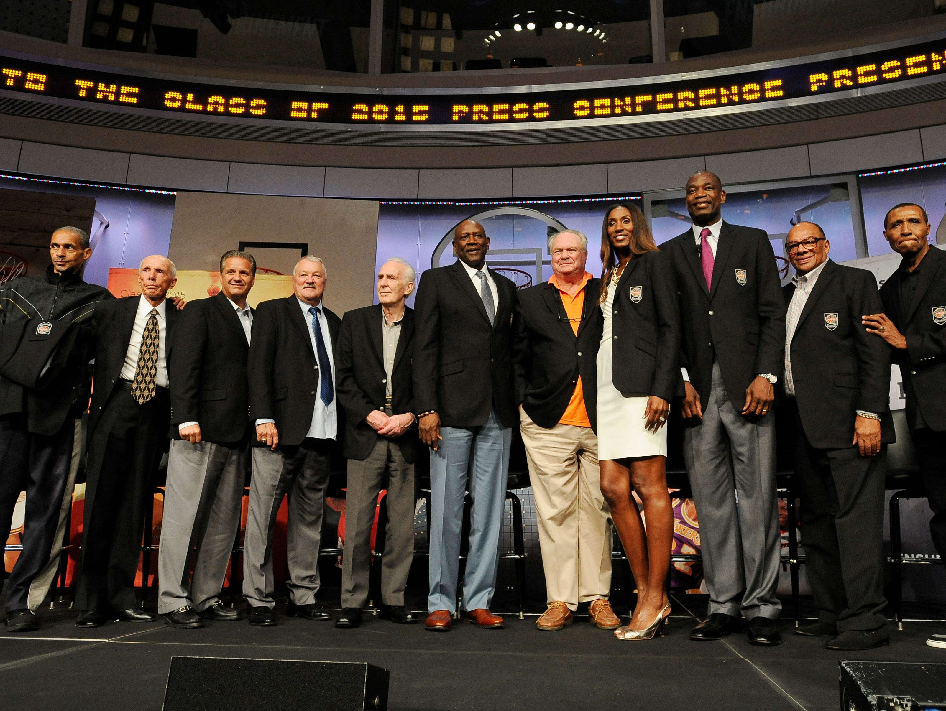 The 2015 class of inductees into the Basketball Hall of Fame, from the left, Alex Isaacs, accepting on behalf of his father John Isaacs, Dick Bavetta, John Calipari, Louis Dampier, Lindsay Gaze, Spencer Haywood, Tom Heinsohn, Lisa Leslie, Dikembe Mutombo, George Raveling, and Jo Jo White pose at a news conference at the Naismith Memorial Basketball Hall of Fame Thursday, Sept. 10, 2015, in Springfield, Mass.