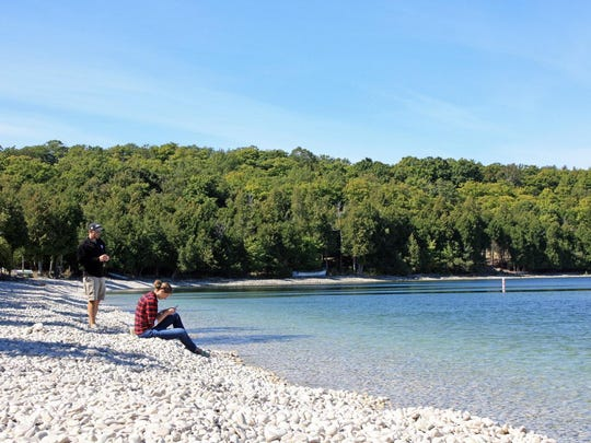 Schoolhouse Beach on Washington Island features smooth, limestone rocks along its shore instead of sand.