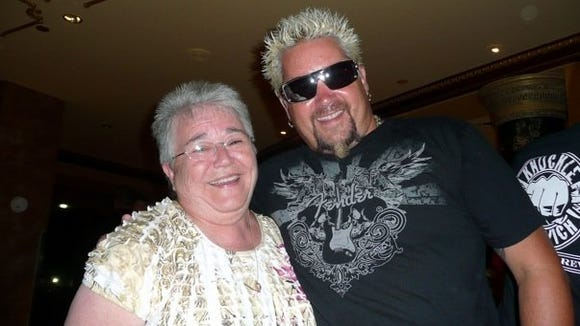 The author's mom and Guy Fieri in Atlantic City. The TV star and restaurant owner joked that the two had the same barber.