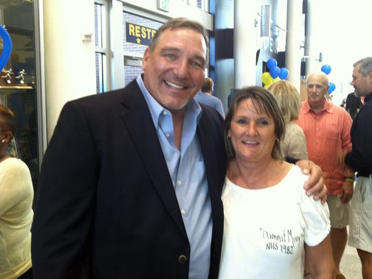 Dave Walker poses with Missy Zellif at Walker's retirement party in April 2012 after coaching the Naples girls basketball team for 33 years. Zellif was a freshman point guard on Walker's first Golden Eagles team in the 1979-80 season.