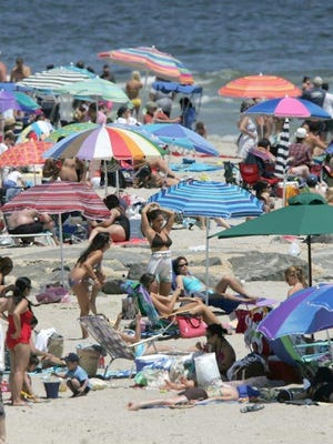 Beach goers enjoy the sun at Long Branch