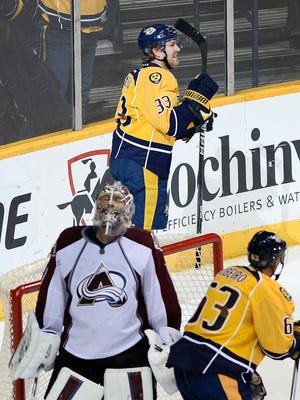 Predators center Colin Wilson (33) celebrates after scoring against Avalanche goalie Semyon Varlamov (1) in the second period Tuesday.