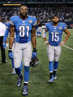 The Detroit Lions Clavin Johnson and Golden Tate  leave the field after the 24-20 loss to the Dallas Cowboys on Sunday, January 4, 2015  AT&T Stadium.