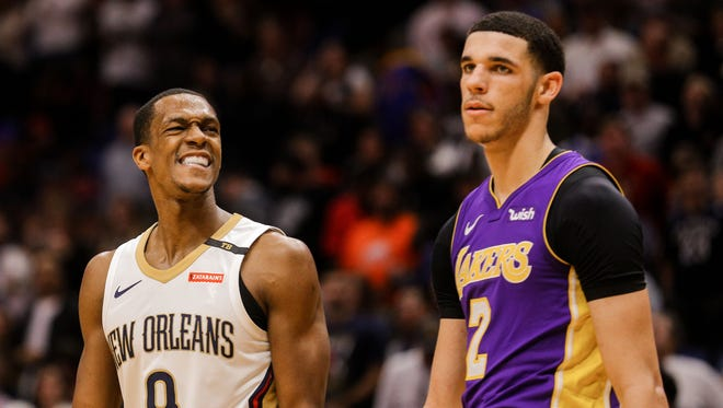 New Orleans Pelicans guard Rajon Rondo (9) smiles towards Los Angeles Lakers guard Lonzo Ball (2) during the fourth quarter at the Smoothie King Center.