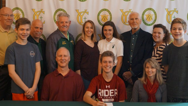 Jim Forjan, second from right in the back row, is seen is this photo when his grandson, York Catholic High School's Andrew Forjan, seated in the center, signed his National Letter of Intent to continue his education and play golf at NCAA Division I Rider University in Lawrenceville, New Jersey.  (Submitted)