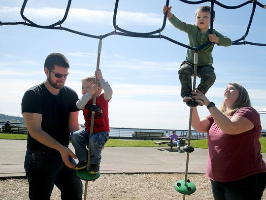 Tammy Harder and her husband, Isaac, take twins Marcus, left, and Lucas to play on the playground at Silverdale Waterfront Park.