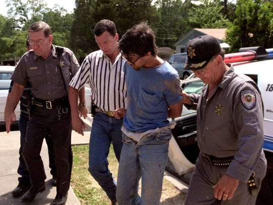 Darrell James Robinson is walked into the Evangeline Parish Courthouse after his capture in May 1996. Robinson later was convicted of fatally shooting four members of a Poland-area family. He received the death penalty.