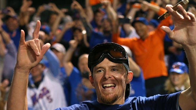 New York Mets relief pitcher Tyler Clippard (46) celebrates after defeating the Chicago Cubs in Game 4 of the NLCS at Wrigley Field.