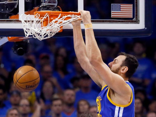 Golden State Warriors center Andrew Bogut (12) dunks against the Oklahoma City Thunder during the first half in Game 6 of the NBA basketball Western Conference finals in Oklahoma City, Saturday, May 28, 2016. (AP Photo/Sue Ogrocki)