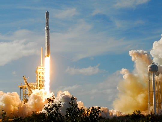 SpaceX's newest rocket, the Falcon Heavy lifts off
