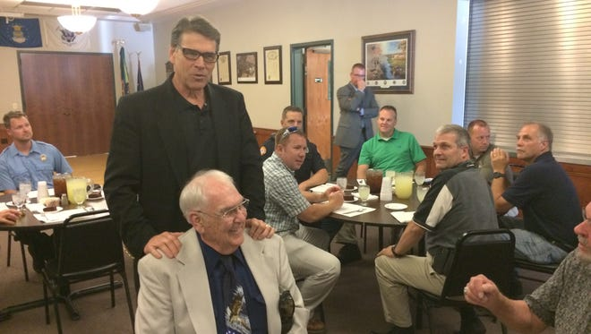 Texas Gov. Rick Perry visits with Wade Baago, a veteran from Clear Lake, during a visit to the VFW post on Sunday.