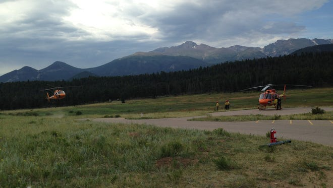 A helicopter arrives at Upper Beaver Meadows  from Loomis Lake in Rocky Mountain National Park, transporting Nick Creadon.