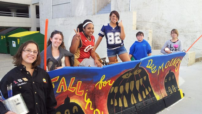 Madilyn TS-Kearney, Lisette Criger, Sequoia Stanton, Liam Donnelly and Grace Hardt from Gateway Secondary School helped paint a city of Des Moines snowplow that was used for plowing roads winter of 2013.