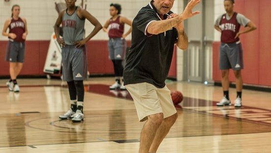 New Mexico State women's basketball head coach Mark Trakh coaching defensive techniques during the Aggies' first practice of the season Sunday afternoon at the Pan American Center practice gym.
