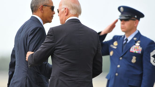 President Barack Obama along with Vice President Joe Biden leave the Orlando International Airport Thursday afternoon after meeting with the families of victims of the mass shooting at Pulse nightclub in Orlando .