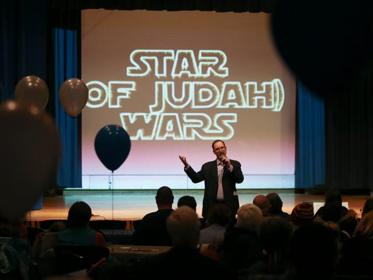 "Head of School Rabbi Jeremy Winaker introduces the Hanukkah/Star Wars mashup production ""Star (of Judah) Wars"" as Albert Einstein Academy students get set for the stage production at the Siegel JCC Thursday."
